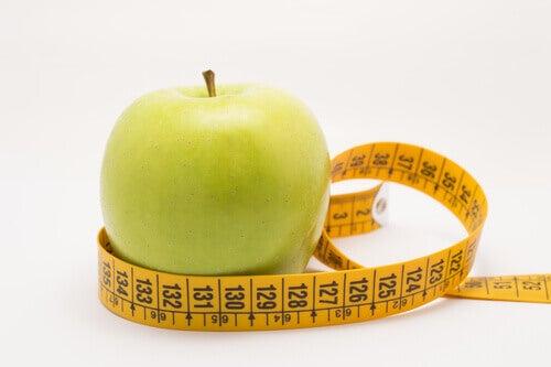 måttband runt äpple