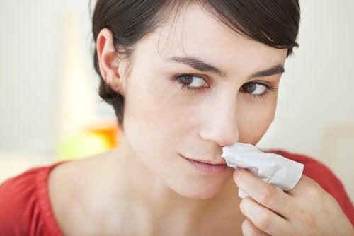 Näsblod-kvinna