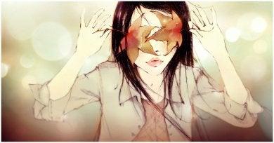 kvinna med löv på ögonen
