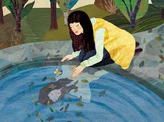 Kvinna i en vattenspegel