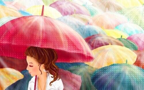Färgglada paraplyn för molniga dagar