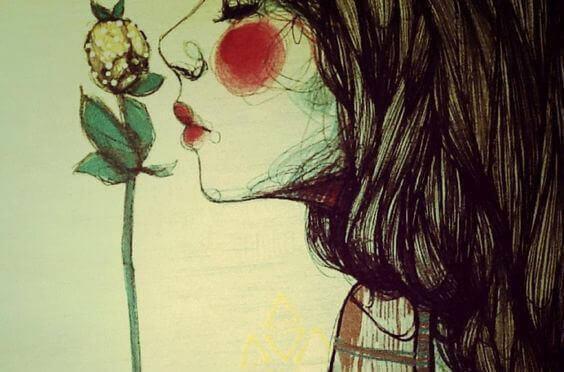 kvinna-luktar-pa-blomma