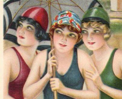 personer i baddräkt under paraply