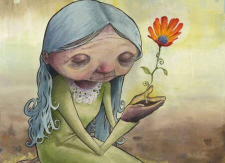 Gammal kvinna med blomma