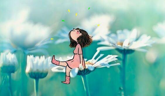 Flicka på blomma