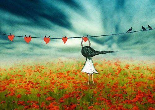 flicka hänger hjärtan på tork