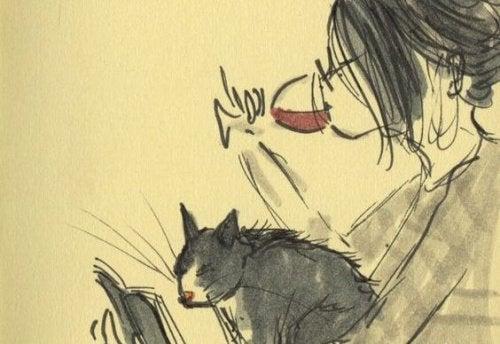 kvinna med katt och ett glas rött vin