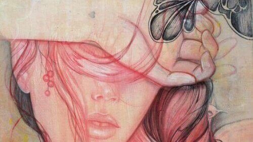 Kvinna håller för ögonen