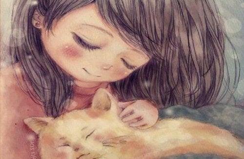 Flicka med katt