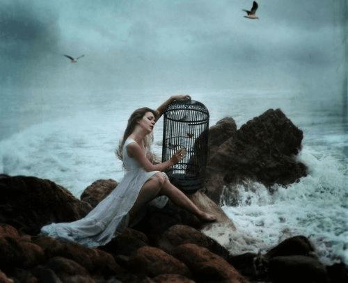 Kvinna med bur