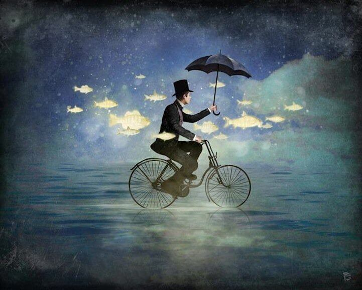 Cyklande man med paraply