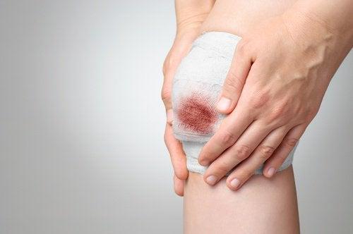 knä med bandage