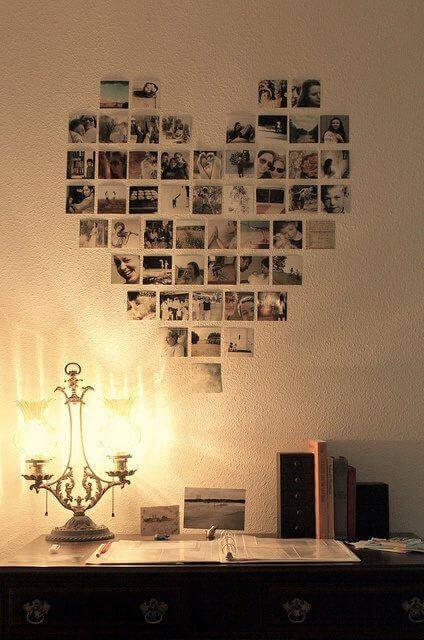 ett hjärta på väggen av foton