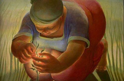 Kvinna sköter om liten växt