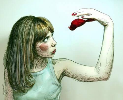 Kvinna som håller fågel