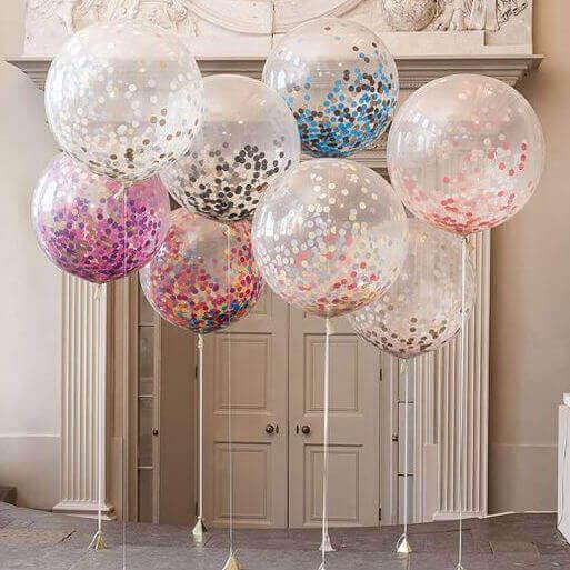 Genomskinliga ballonger med konfetti.