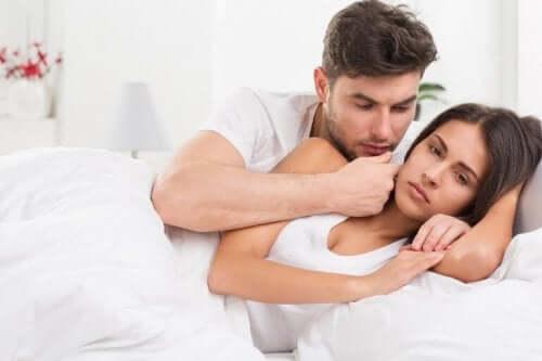 Kvinna med problem i sängen