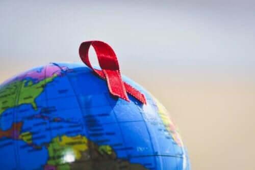 Humant immunbristvirus: rött band på jordglob